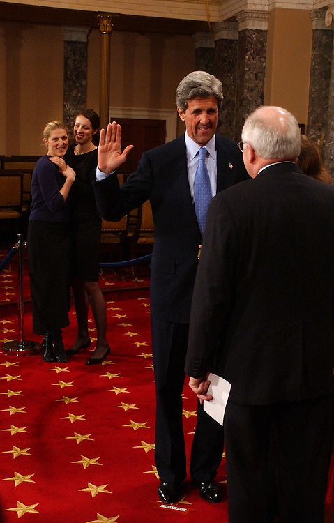 senateswearin1/010703 -- Sen. John Kerry, D-Mass., is sworn into the 108th Congress by Vice President Dick Cheney in the Old Senate Chamber, as Kerry's daughters Vanessa, in blue, and Alexandra, look on .