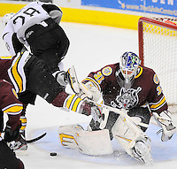 San Antonio Rampage's James Wright, left, goes airborne as he is tripped up after shooting on Chicago Wolves goaltender Eddie Lack during the second period of an AHL hockey game, Thursday, April 19, 2012, in San Antonio. (Darren Abate/pressphotointl.com)