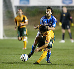 27 March 2004: Carlos Ruiz (20) and Diego Walsh collide while challenging for the ball in the 31st minute. Ruiz was injured on the play and forced to leave the game. Los Angeles Galaxy defeated the Kansas City Wizards 1-0 at SAS Stadium in Cary, NC in the final preseason game for both Major League Soccer teams as part of the Cary Pro Kickoff Invitational tournament..