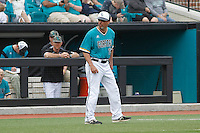 University of Coastal Carolina Chanticleers head coach Gary Gilmore (14) coaching third base during a game against the University of Virginia Cavaliers at Springs Brooks Stadium on February 21, 2016 in Conway, South Carolina. Coastal Carolina defeated Virginia 5-4. (Robert Gurganus/Four Seam Images)
