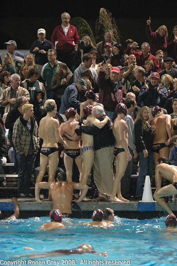 Saturday,November 22 2008.  Bishops High Schoo water polo players join their families in celebration as Coronado High supporters (left) look on.  Bishops, of La Jolla defeated Coronado High 4 to 3 for the CIF Division II Boys Water Polo Title.  Bishops coach in the water in foreground.