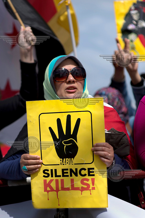 Supporters of ousted Egyptian president Mohamed Morsi protest during the state visit of the Egyptian President Abdel Fattah Saeed Hussein Khalil el-Sisi.