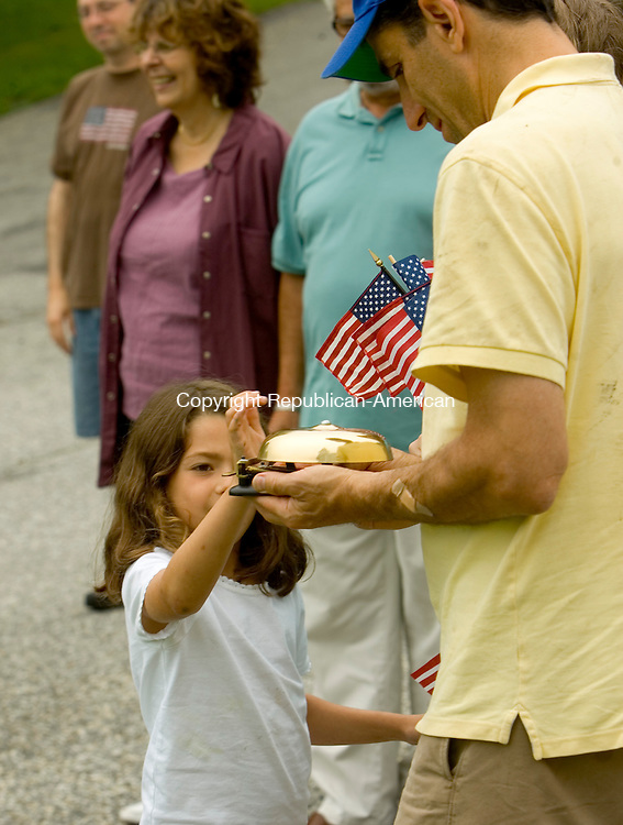 WARREN, CT --JULY 04, 2008-070408JS04-Elena Zipp of Warren, rings a bell being held by ther father Brian Zipp during the annual Warren Independence Day bell ringing ceremony Friday. The event was sponsored by the Warren Historical Society. <br /> Jim Shannon/Republican-American