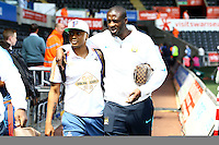 Andre Ayew of Swansea City and Yaya Toure of Manchester City talk as they arrive together before the Barclays Premier League match between Swansea City and Manchester City played at The Liberty Stadium, Swansea on 15th May 2016