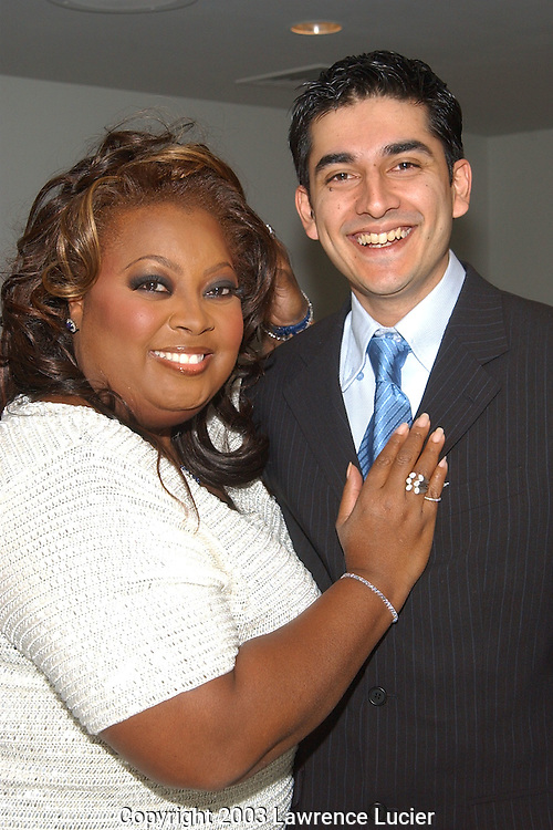 NEW YORK-FEBRUARY 5: Talk show personality Star Jones (L) purchases a pavet diamond set in 18k white gold from jeweler Faisal Joo (R) at a jewelry show featuring his designs February 5, 2003, at the Paramount Hotel in New York City.  A portion of the sales will support the charity America Shares.