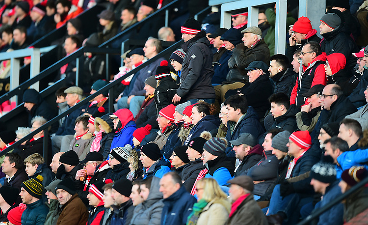 Lincoln City fans watch their team in action<br /> <br /> Photographer Andrew Vaughan/CameraSport<br /> <br /> The EFL Sky Bet League Two - Lincoln City v Northampton Town - Saturday 9th February 2019 - Sincil Bank - Lincoln<br /> <br /> World Copyright &copy; 2019 CameraSport. All rights reserved. 43 Linden Ave. Countesthorpe. Leicester. England. LE8 5PG - Tel: +44 (0) 116 277 4147 - admin@camerasport.com - www.camerasport.com