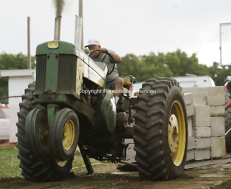TERRYVILLE,  CT 17 September 2005 -091705BZ12-  Don Duksa, of Ancran, NY, lifts the front wheels of his John Deere 730 tractor off the ground while pulling 21,400 pounds during competition at the Terryville Fair Saturday. Duksa came in third place in this class.<br /> <br />  Jamison C. Bazinet / Republican-American