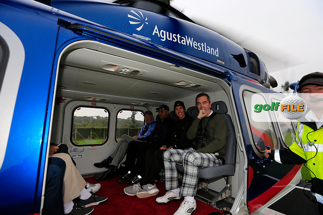 Thorbjorn Olessen and James Nesbitt  in the back of the AW139 for the flight to Carnoustie from St Andrews during the Alfred Dunhill Links Championship.<br /> <br /> Picture Fran Caffrey www.golffile.ie