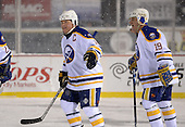 Danny Gare (18) and Derek Smith (19) celebrate a goal during The Frozen Frontier Buffalo Sabres vs. Rochester Amerks Alumni Game at Frontier Field on December 15, 2013 in Rochester, New York.  (Copyright Mike Janes Photography)