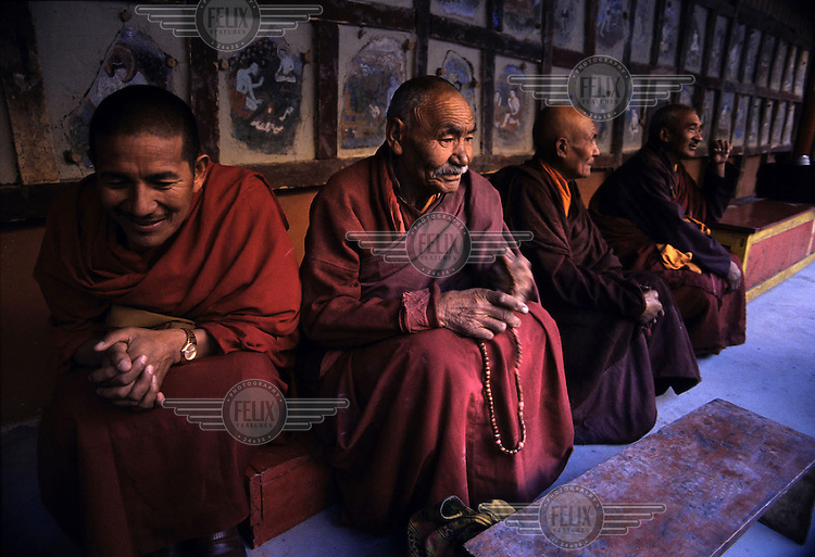 Elderly monks wait for a mask dance to begin at Hemis Gompa, the biggest monastery in Ladakh. It was built in 1630 and houses monks of the Brokpa or Red Hat sect. The Hemis Gompa is famous for its annual Tse Chu Festival which is characterised by colourful masked dancers wearing masks that represent good and evil characters in Mahayana Buddhism, an age-old tale of the victory of good over evil...