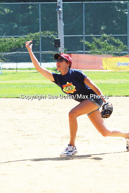 Countess LuAnn de Lessups pitches at the 63rd Annual Charity Softball Game 2011 - Artists versus Writers to benefit East Hampton Day Care Learning Center, East End Hospice and Phoenix Houses of Long Island - played at Herrick Park, East Hampton, New York. (Photo by Sue Coflin/Max Photos)