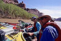 Group of male kayakers rafting up for a refreshment break ,Green River, Canyonlands National Park, Utah