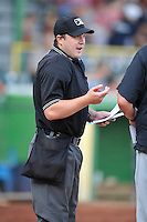 Home plate umpire Cameron Westover goes over the rules with both managers prior to the start of the game between the South Bend Sliver Hawks and the the Clinton LumberKings at Ashford University Field on July 26, 2014 in Clinton, Iowa. The Sliver Hawks won 2-0.   (Dennis Hubbard/Four Seam Images)
