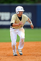 4 March 2012:  FIU catcher Aramis Garcia (24) runs to third base as the FIU Golden Panthers defeated the Brown University Bears, 8-3, at University Park Stadium in Miami, Florida.