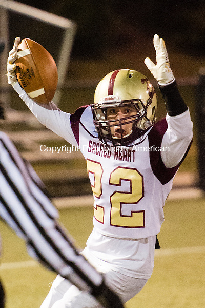 WATERBURY, CT - 25 November 2015-112515EC03--  Action man. Sacred Heart's Joel Guzman scores a touchdown against Wilby Friday night. Erin Covey Republican-American.