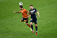 29th July 2020; Bankwest Stadium, Parramatta, New South Wales, Australia; A League Football, Melbourne Victory versus Brisbane Roar; Scott McDonald of Brisbane Roar and Aaron Anderson of Melbourne Victory challenges for the ball