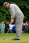 Darren Clarke (NIR) takes his putt on the 1st green during the Final Day of the BMW PGA Championship Championship at, Wentworth Club, Surrey, England, 29th May 2011. (Photo Eoin Clarke/Golffile 2011)