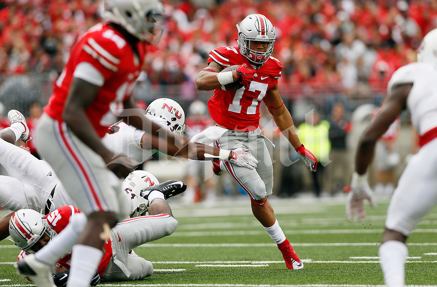 Ohio State Buckeyes running back Jalin Marshall (17) runs up the middle during the first quarter of the NCAA football game against the Northern Illinois Huskies at Ohio Stadium in Columbus on Sept. 19, 2015. (Adam Cairns / The Columbus Dispatch)