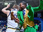Feb 23, 2020; Rex Pflueger (0) celebrates with Leprechaun Samuel Jackson after Notre Dame defeated Miami. (Photo by Matt Cashore)