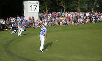 Scott Hend (AUS) sinks the putt for par during Round Three of the 2016 BMW PGA Championship over the West Course at Wentworth, Virginia Water, London. 28/05/2016. Picture: Golffile   David Lloyd. <br /> <br /> All photo usage must display a mandatory copyright credit to © Golffile   David Lloyd.