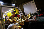 VAN, TURKEY: Rescue workers pull a survivor from the rubble and take him to an ambulance...On October 23, 2011, a 7.2 magnitude earthquake hit eastern Turkey killing over 250 people and wounding over a thousand...Photo by Ali Arkady/Metrography