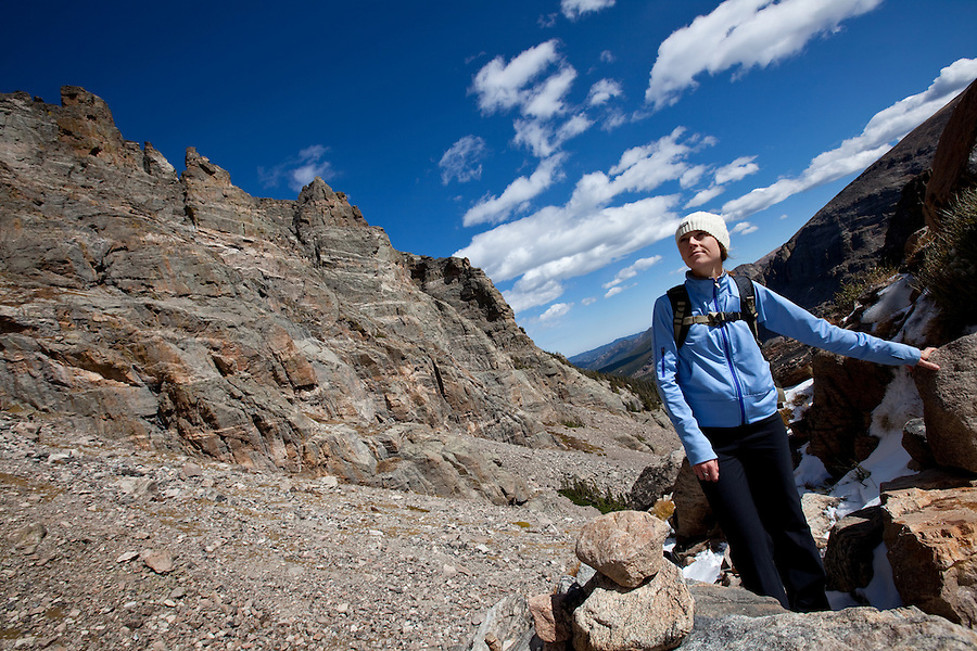 A hiker pauses to admire the view near Andrews Glacier, in Colorado's Rocky Mountain National Park.