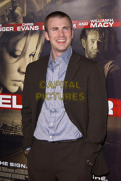 "CHRIS EVANS.New Line Cinema's World Premiere of ""Cellular"" held at The Cinerama Dome in Hollywood, California .September 9, 2004.half length, striped shirt, hands in pockets, black suit.www.capitalpictures.com.sales@capitalpictures.com.Copyright by Debbie VanStory."