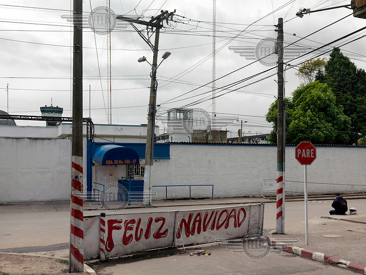 La Modelo high security prison in Bogota. Built in 1957 with a capacity for 5,810 inmates, in August 2015 it held 7,567 prisoners. A 'Happy Christmas' slogan is painted on sign beside the road, in August.