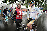 2 former cyclocross world champions both riding the National Road Championship: 1 as a moto official (Paul Herygers) and 1 as a rider (Bart Wellens, BEL/Telenet-Fidea)<br /> <br /> Belgian Championships 2014 - Wielsbeke<br /> Elite Men