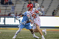 College Park, MD - April 27, 2019: Maryland Terrapins midfielder Logan Wisnauskas (12) avoids a defender during the game between John Hopkins and Maryland at  Capital One Field at Maryland Stadium in College Park, MD.  (Photo by Elliott Brown/Media Images International)