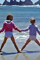 Friends play, Seal Rock, Oregon
