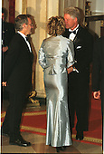 Kate Capshaw (in blue) and her husband, Steven Spielberg, meet President  Clinton at the 1999 Medal of Arts and Humanities Dinner at the White House in Washington, D.C. on September 29, 1999..Credit: Ron Sachs / CNP