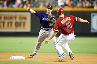 Colorado Rockies second baseman Josh Rutledge #14 attempts to turn a double play as AJ Pollock #11 slides in during a National League regular season game against the Arizona Diamondbacks at Chase Field on October 3, 2012 in Phoenix, Arizona. Colorado defeated Arizona 2-1. (Mike Janes/Four Seam Images)