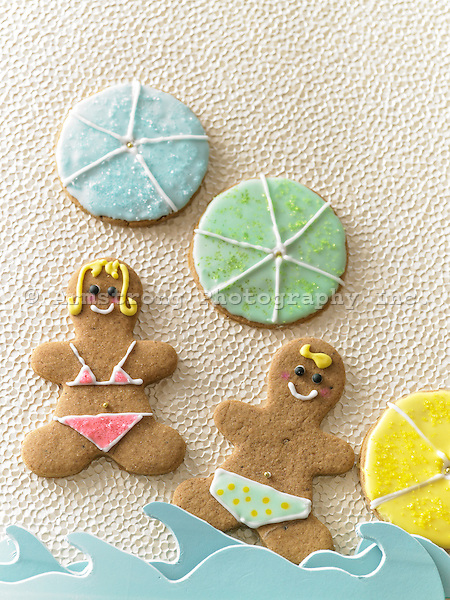 Ginger bread cookies decorated with swimsuits and beach ball cookies