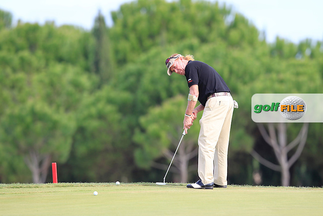 Miguel Angel Jimenez (ESP) putts on the 14th green during Sunday's Final Round of the 2013 Portugal Masters held at the Oceanico Victoria Golf Club. 13th October 2013.<br /> Picture: Eoin Clarke/www.golffile.ie