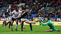 Bolton Wanderers' Clayton Donaldson competing with Reading's Matt Miazga as Reading's goalkeeper Emiliano Martinez saves<br /> <br /> Photographer Andrew Kearns/CameraSport<br /> <br /> The EFL Sky Bet Championship - Bolton Wanderers v Reading - Tuesday 29th January 2019 - University of Bolton Stadium - Bolton<br /> <br /> World Copyright © 2019 CameraSport. All rights reserved. 43 Linden Ave. Countesthorpe. Leicester. England. LE8 5PG - Tel: +44 (0) 116 277 4147 - admin@camerasport.com - www.camerasport.com