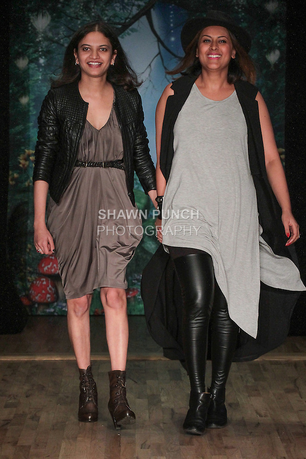 Fashion designers Saloni Mittal and Radha Nadkarni walk runway at the close of their Marin + Morgan Fall Winter Fall Winter 2016 collection fashion show, at the Posh Magazine, Fashion Carnaval fashion show in WeWork in New York City, on March 19, 2016.