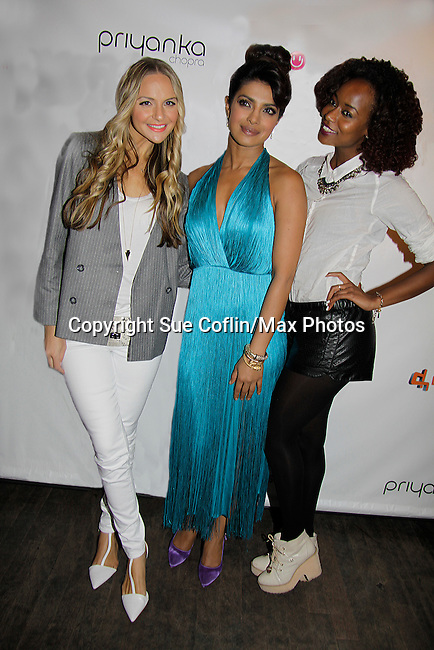 """VH1's Jackie Miranne (Big Morning Buzz Live) and Annaliese Dayes (America's Top Model) pose with actress/singer Priyanka Chopra who is celebrating international recording of Priyanka's world video premier of her new single """"I Can't Make You Love Me"""" with a private screening on April 28, 2014 at the Tribeca Grand Hotel, New York City, New York.  (Photo by Sue Coflin/Max Photos)"""
