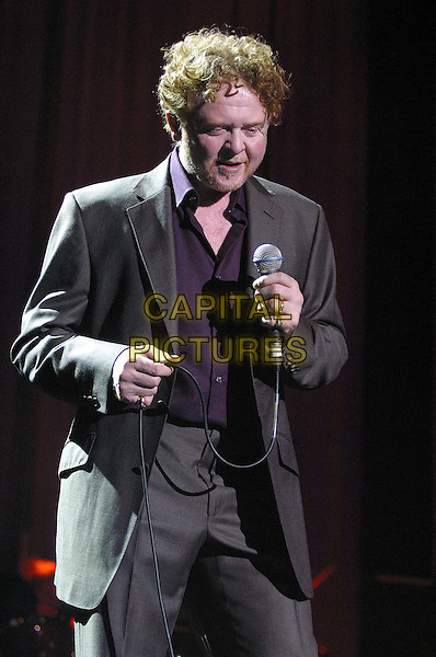 MICK HUCKNALL.Simply Red Live at Nottingham Ice Arena, Nottingham..UK, United Kingdom..9th October 2005.Ref: JEZ.half length on stage performing live gig concert music singing microphone large screen tv.www.capitalpictures.com.sales@capitalpictures.com.©Capital Pictures