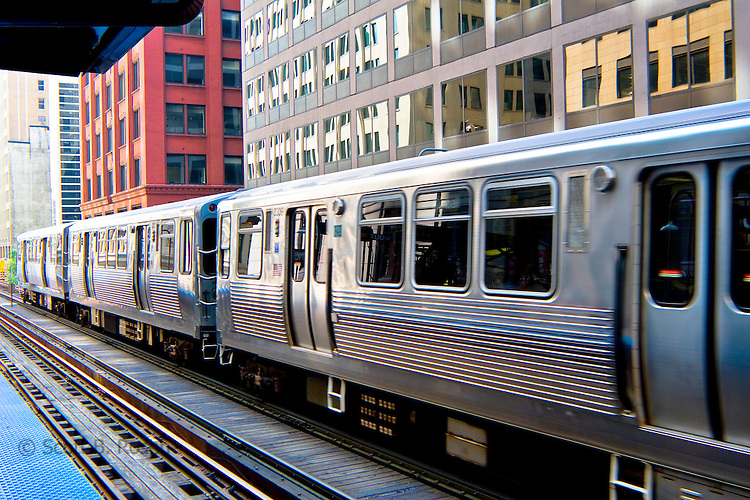 "The Chicago ""L"" train leaves a station in the Loop, downtown, Chicago, Ilinois"