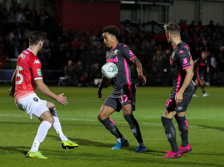 Leeds United's Helder Costa tries to control the ball under pressure from Salford City's Cameron Burgess<br /> <br /> Photographer Alex Dodd/CameraSport<br /> <br /> The Carabao Cup First Round - Salford City v Leeds United - Tuesday 13th August 2019 - Moor Lane - Salford<br />  <br /> World Copyright © 2019 CameraSport. All rights reserved. 43 Linden Ave. Countesthorpe. Leicester. England. LE8 5PG - Tel: +44 (0) 116 277 4147 - admin@camerasport.com - www.camerasport.com