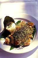 A presentation of fried poke, a chunked, marinated Hawaian-style fish and seaweed