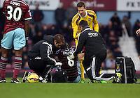 Sunday 07 December 2014<br /> Pictured: Cheikhou Kouyate of West Ham injured on the ground<br /> Re: Premier League West Ham United v Swansea City FC at Boleyn Ground, London, UK.