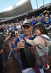 Norichika Aoki (Royals),<br /> OCTOBER 15, 2014 - MLB : Norichika Aoki of the Kansas City Royals and his daughter celebrate the series trophy after winning the Major League Baseball American League Championship Series against the Baltimore Orioles Game 4 at against the Baltimore Orioles at Kauffman Stadium in Kansas City, Missouri, USA. <br /> (Photo by AFLO)