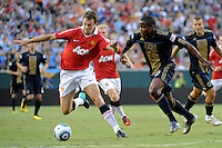 Jonny Evans (23) of Manchester United holds off Danny Mwanga (10) of the Philadelphia Union. Manchester United (EPL) defeated the Philadelphia Union (MLS) 1-0 during an international friendly at Lincoln Financial Field in Philadelphia, PA, on July 21, 2010.