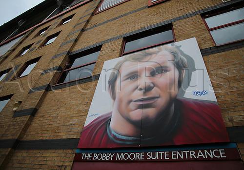 27.02.2016. Boleyn Ground, London, England. Barclays Premier League. West Ham versus Sunderland. A fitting art piece of Bobby Moore, above the The Boleyn Ground Bobby Moore Suit entrance door