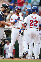 Buffalo Bisons outfielder Dalton Pompey (31) congratulates Kevin Pillar (22) after a home run with Darin Mastroianni (44) looking on during a game against the Pawtucket Red Sox on August 23, 2014 at Coca-Cola Field in Buffalo, New  York.  Buffalo defeated Pawtucket 15-2.  (Mike Janes/Four Seam Images)