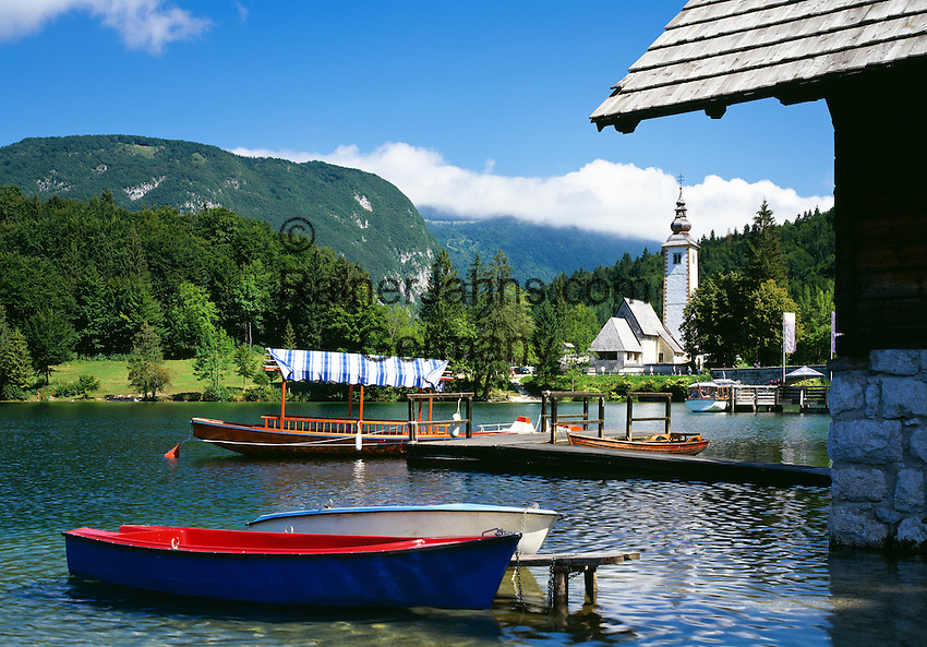 Slovenia, Gorenjska, Slovenian Corinthia, Lake Bohinj (Bohinjsko jezero) at Triglav-National Park, church of St. John (the Baptist), boat rental