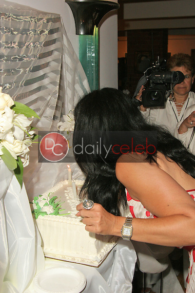 Maria Conchita Alonso blows out the candles<br /> at Maria Conchita Alonso's Surprise Birthday Party, Private Residence, Los Angeles, CA 06-25-05<br /> David Edwards/DailyCeleb.Com 818-249-4998<br /> EXCLUSIVE