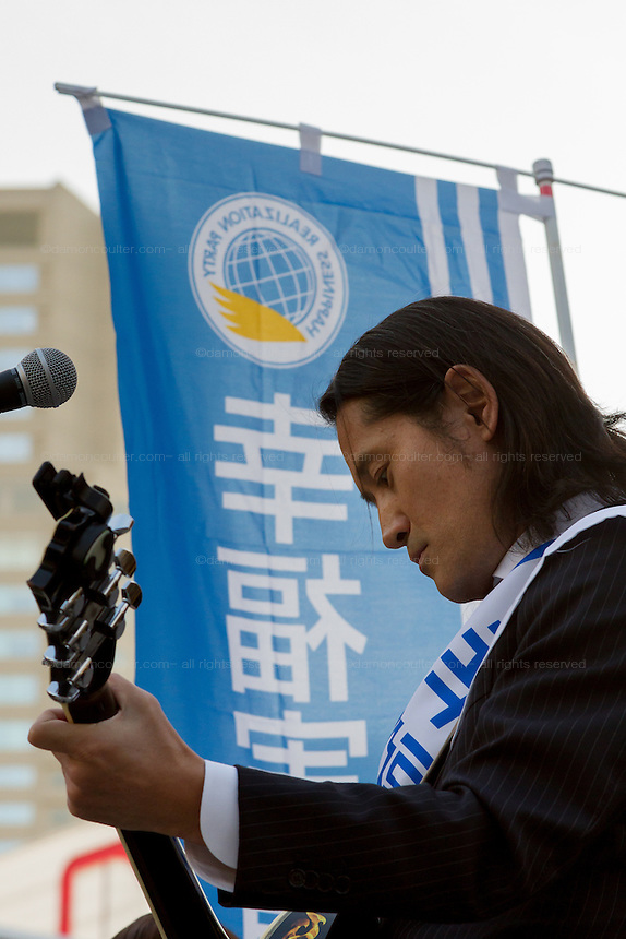 Musician, Tokma campaigning for the right-wing Happiness Realization party in Shibuya, Tokyo, Japan. Friday November 21st 2014